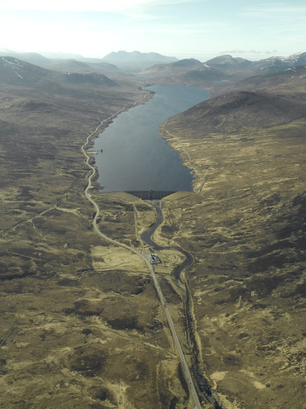 General oblique aerial view of Loch Glascarnoch centred on the dam and electricity generating station with the hotel in the foreground, taken from the ESE.