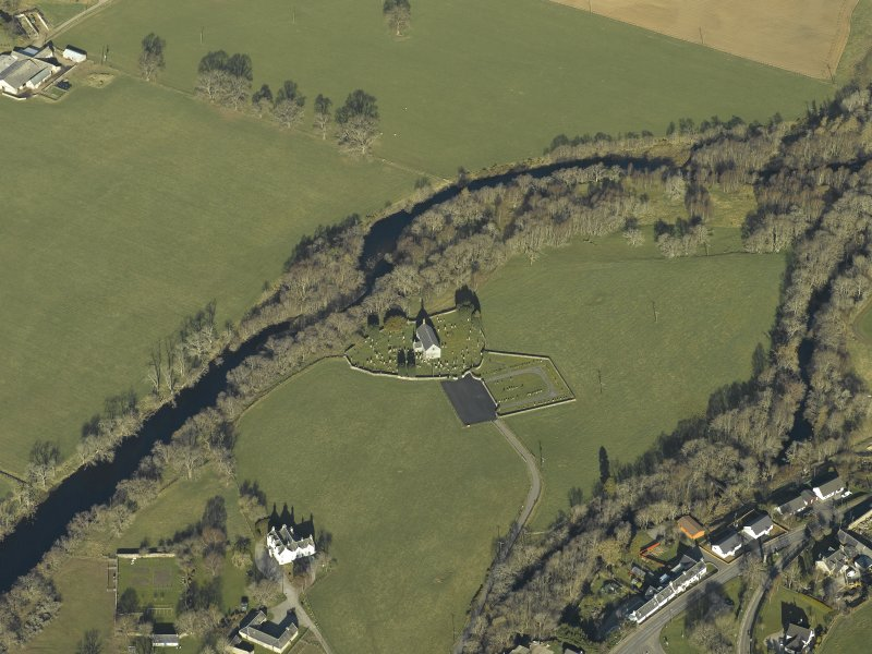 Oblique aerial view centred on the church, burial-ground, stables, farmsteading and manse, taken from the ESE.