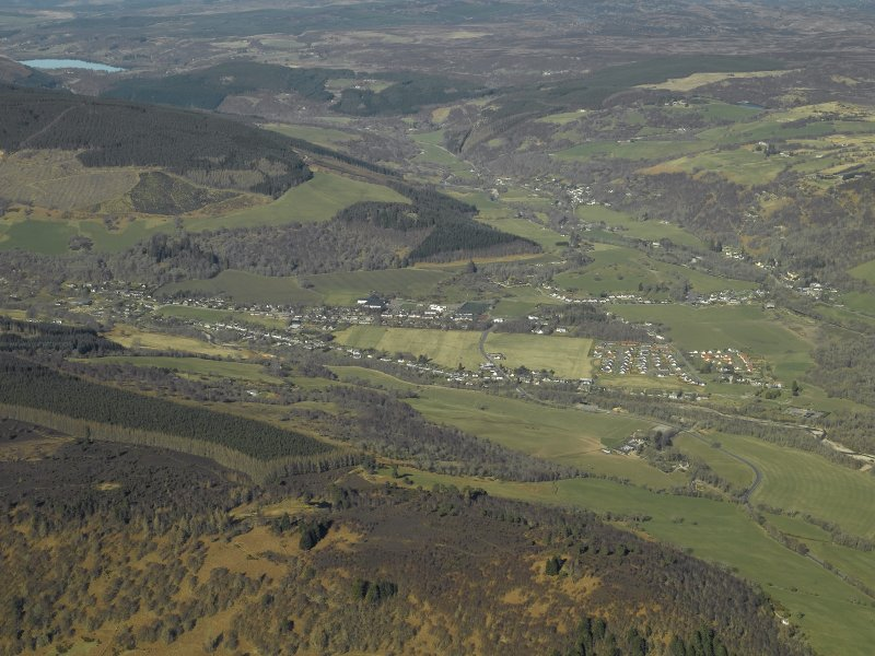 General oblique aerial view centred on the village looking along Glen Urquhart beyond, taken from the SE.