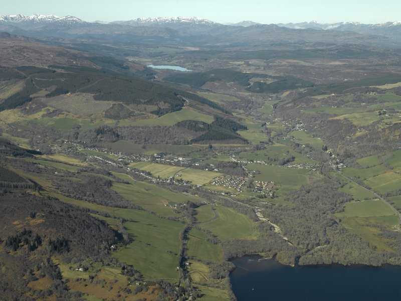 General oblique aerial view centred on the village looking along Glen Urquhart beyond, taken from the ESE.