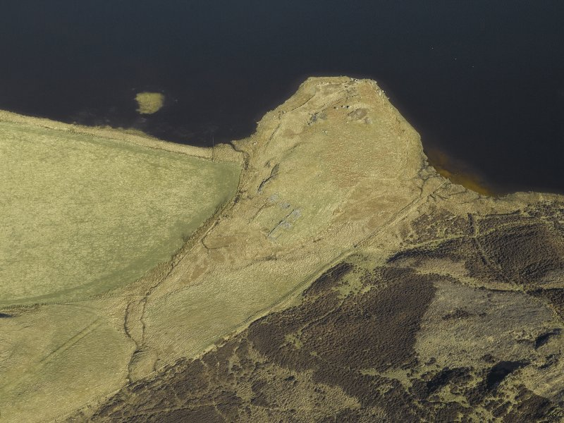 Oblique aerial view centred on the remains of the farmstead and rig, taken from the S.