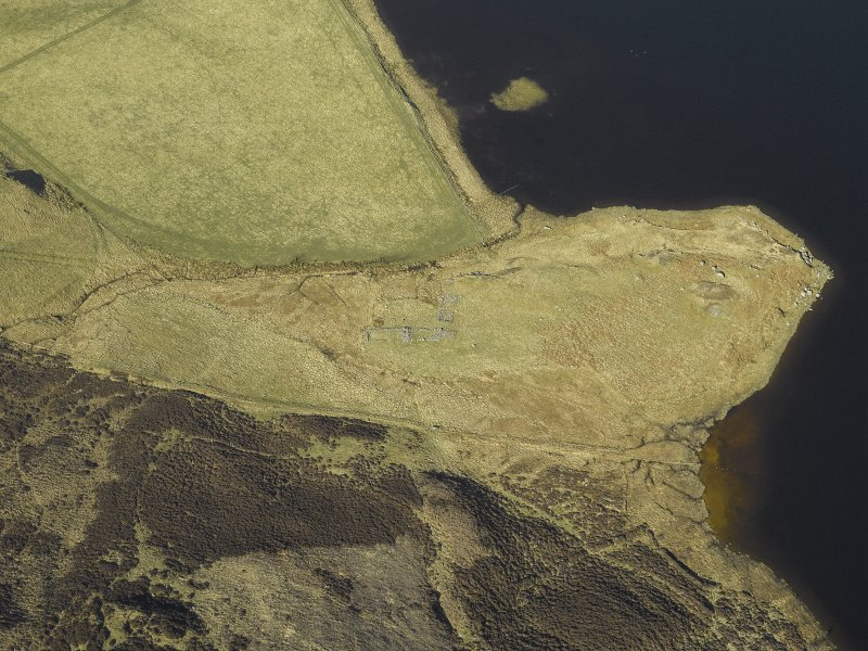 Oblique aerial view centred on the remains of the farmstead and rig, taken from the ESE.