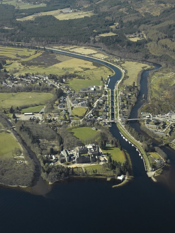 Fort Augustus and Loch Ness.  General oblique aerial view of the village centred on the road bridges, swing bridge, locks, abbey and schools, taken from the E.