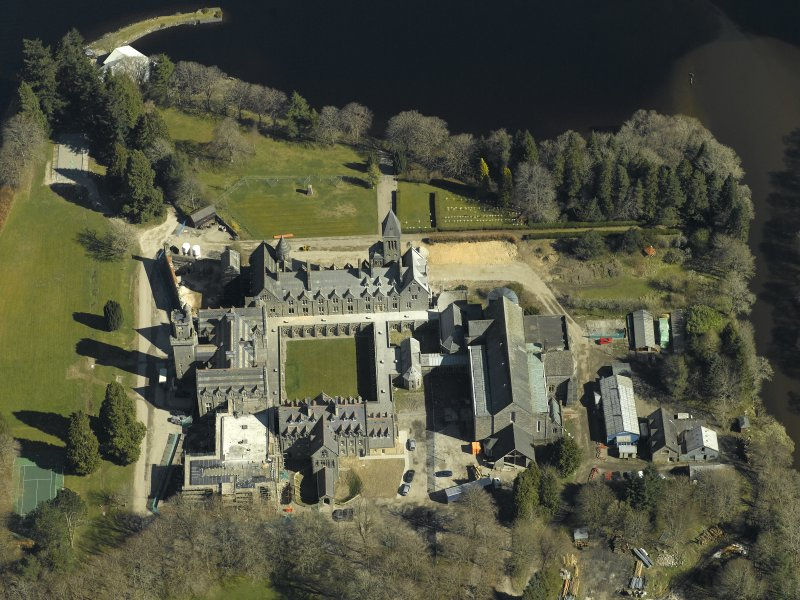 Oblique aerial view centred on the abbey and school, taken from the SW.