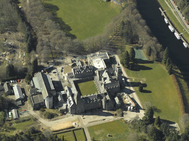 Oblique aerial view centred on the abbey and school, taken from the ENE.