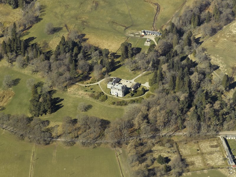 Oblique aerial view centred on the castle and garage with the stables and sawmill adjacent, taken from the SE.