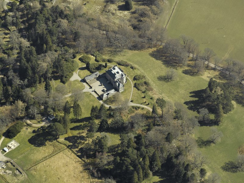 Oblique aerial view centred on the castle and garage, taken from the W.