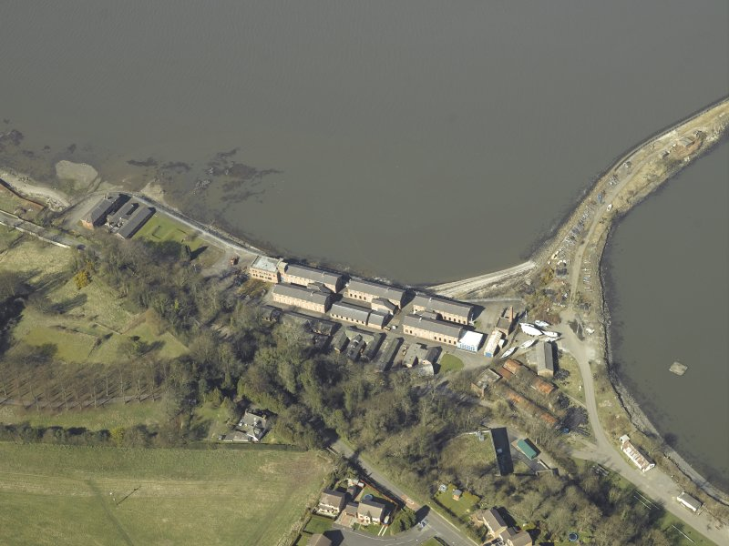 Oblique aerial view centred on the Port Edgar Royal Navy  barracks, officers' quarters, air raid shelter, stores, boiler house and gym, taken from the SSE.
