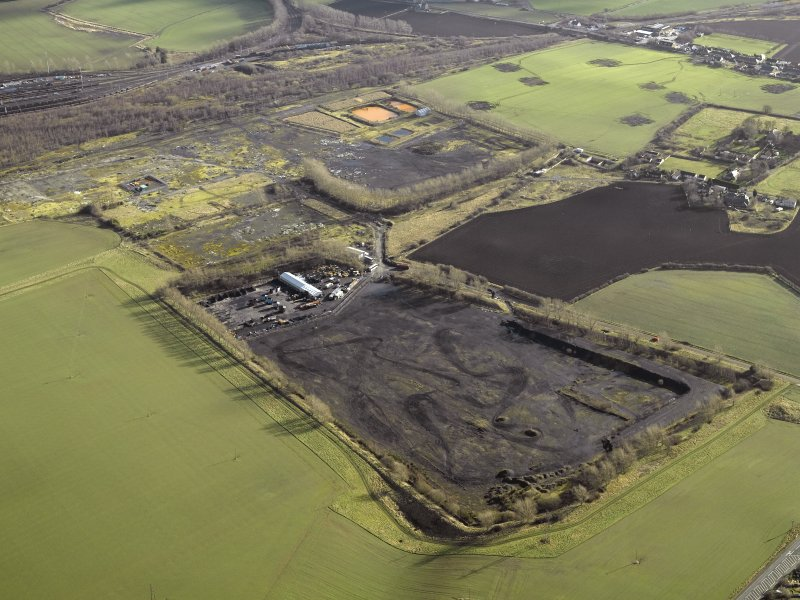 Oblique aerial view centred on former site of colliery, taken from the NW.
