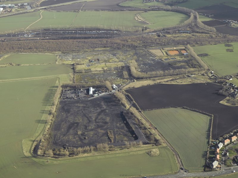 Oblique aerial view centred on former site of colliery, taken from the WSW.