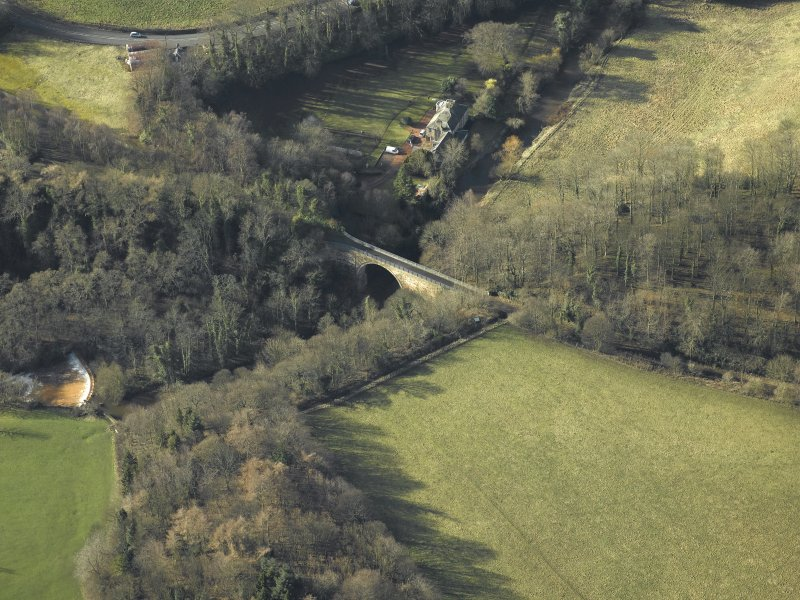 Oblique aerial view centred on Glenesk railway bridge, taken from the SW.