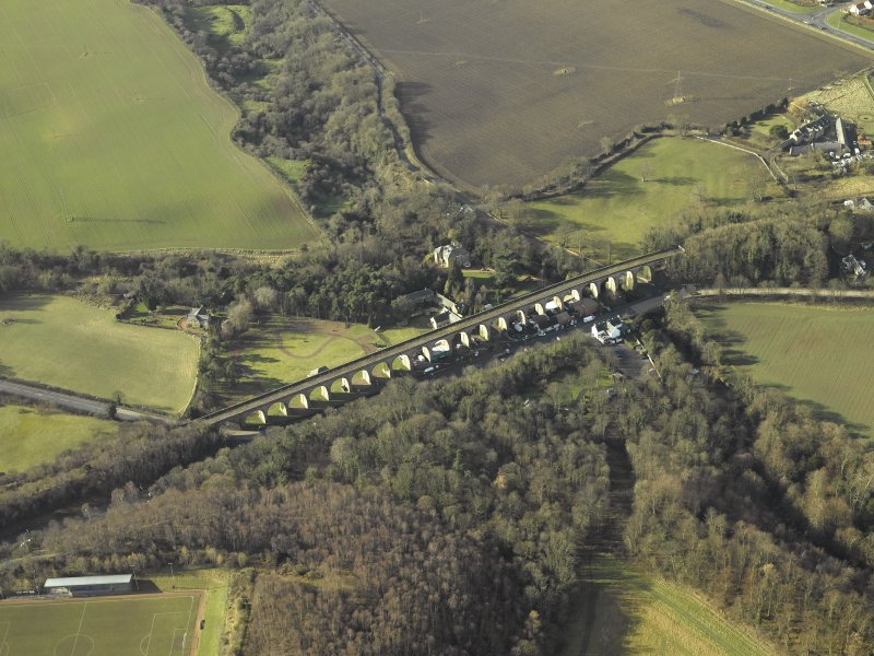 Oblique aerial view centred on Newbattle railway viaduct, taken from the N.