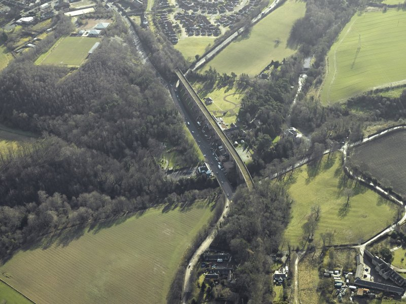 Oblique aerial view centred on Newbattle railway viaduct, taken from the NE.
