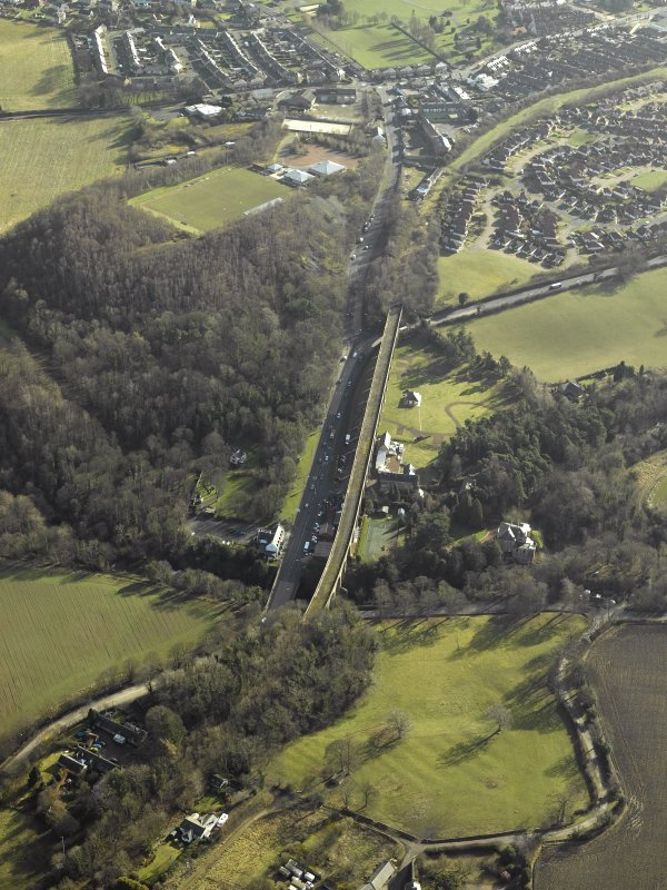 Oblique aerial view centred on Newbattle railway viaduct, taken from the NW.