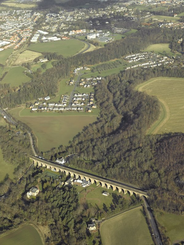 Oblique aerial view centred on Newbattle Railway Viaduct with King's Gate housing estate i the background, taken from the S.