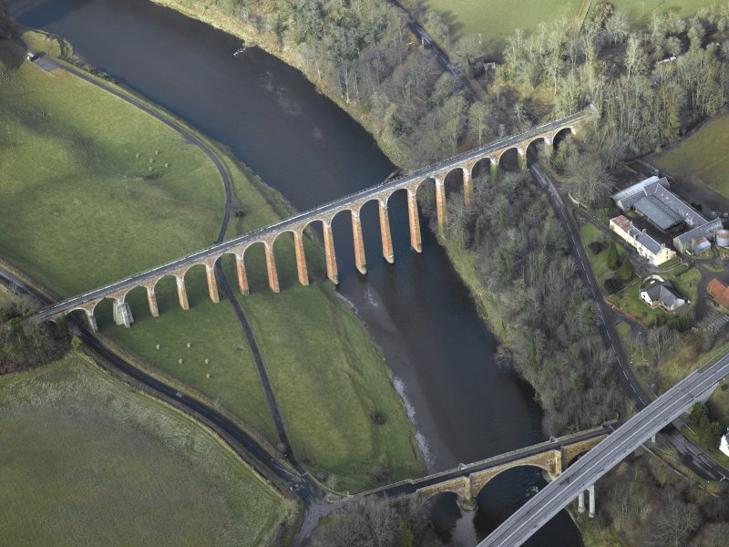 Oblique aerial view centred on the Leaderfoot railway viaduct, Drygrange Bridge and new road bridge, taken from the ESE.