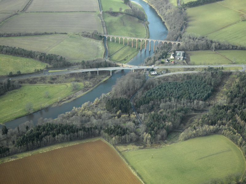 Oblique aerial view centred on the Leaderfoot railway viaduct, Drygrange Bridge and new road bridge, taken from the E.