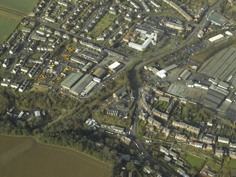 Oblique aerial view centred on the railway station, engine shed and Newtown St Boswells town, taken from the SE.