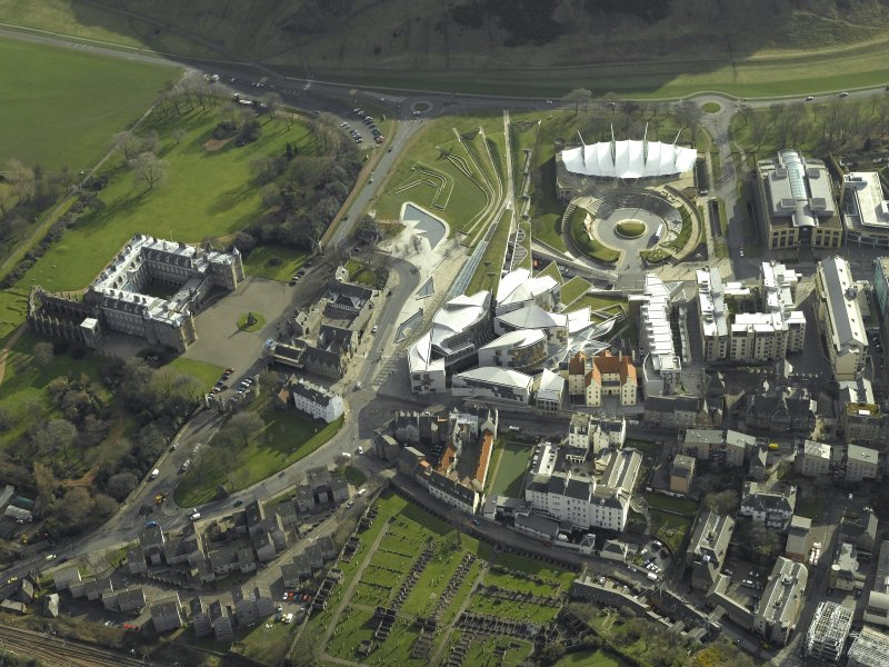 Oblique aerial view centred on Holyrood Palace, Abbey, new Parliament building and 'Our Dynamic Earth', taken from the NW.