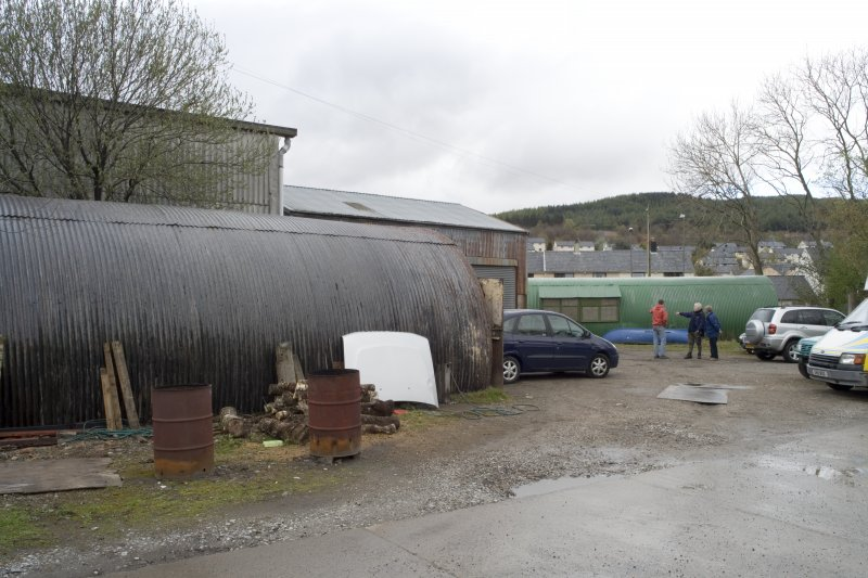 General view from S showing two Nissen huts and part of sheds.