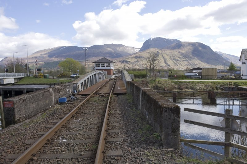 View.  From NW showing railway swing bridge and new signal box looking along railway with Ben Nevis in the background.