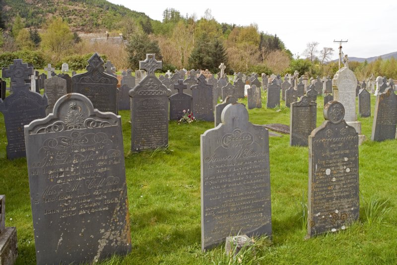 View.  Showing part of burial-ground with mainly 19th century slate grave slabs.