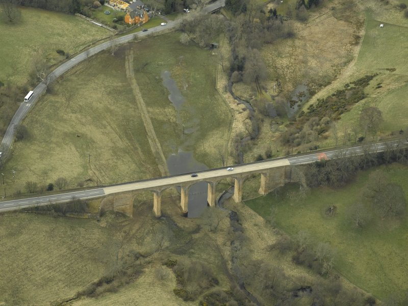Oblique aerial view centred on the road bridge, taken from the NE.