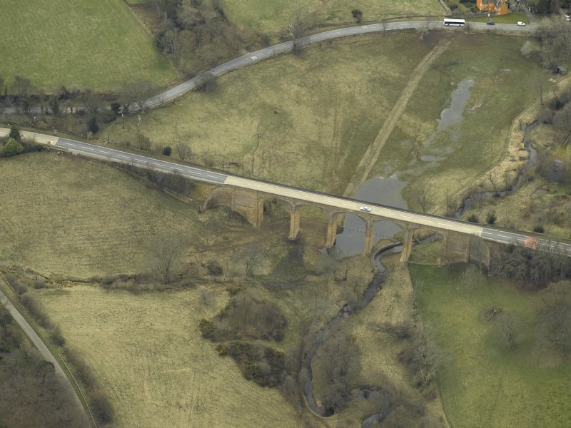 Oblique aerial view centred on the road bridge, taken from the NNE.