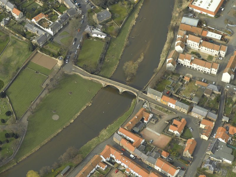 Oblique aerial view centred on the road bridge, taken from the SW.