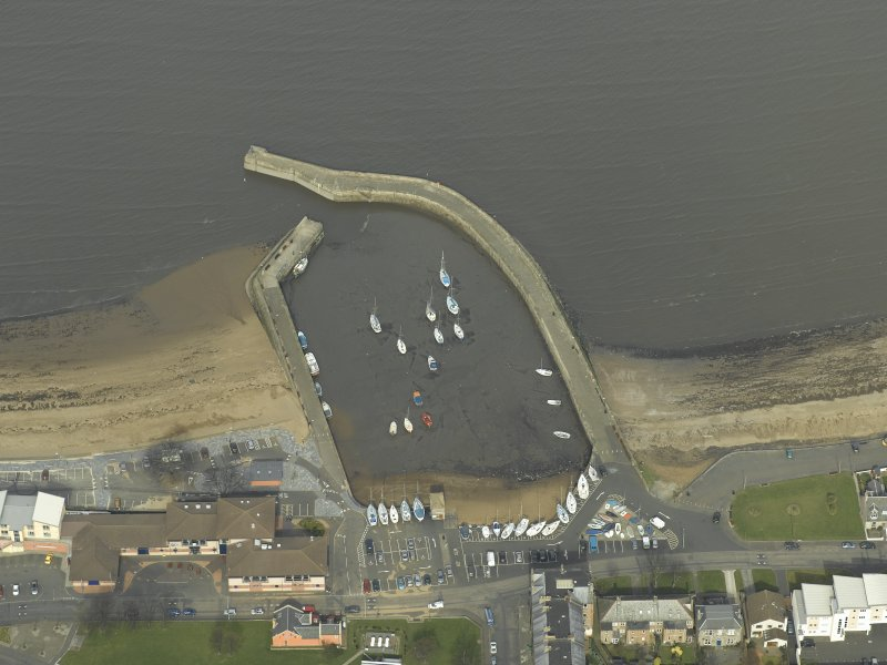 Oblique aerial view centred on the harbour and piers, taken from the S.