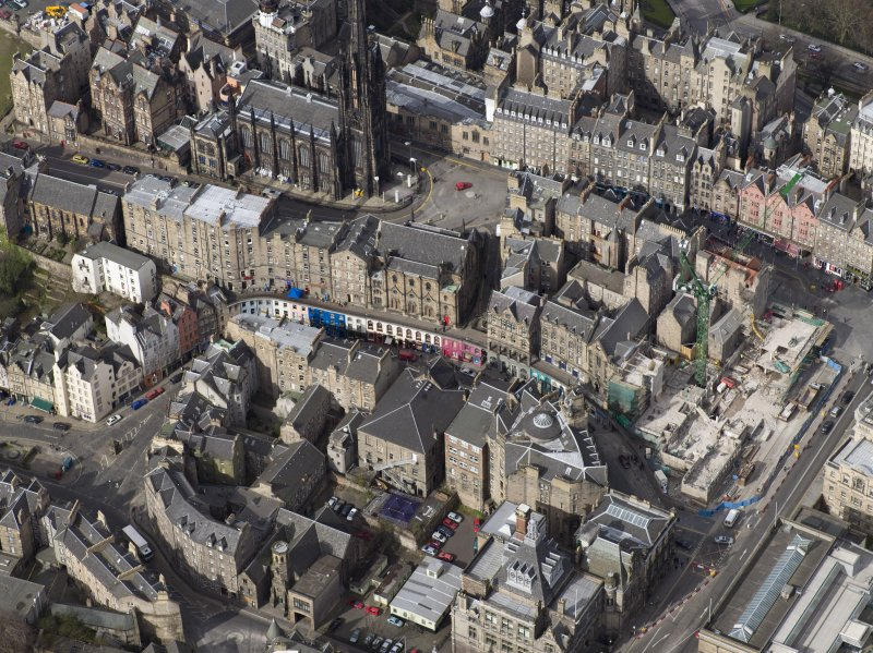 Oblique aerial view of Edinburgh's Old Town centred on Victoria Street with the church adjacent, taken from the SE.