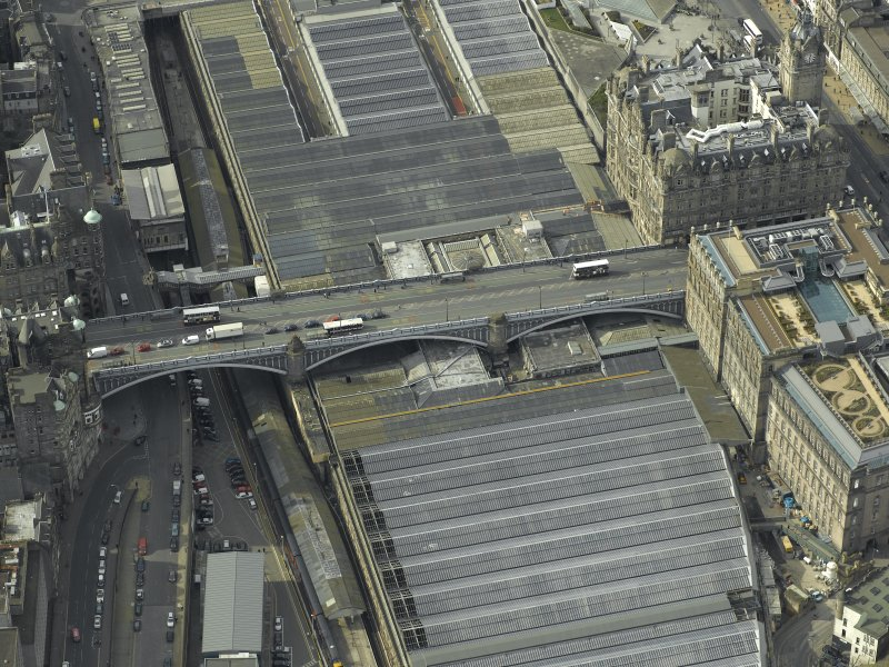 Oblique aerial view centred on the road bridge and railway station, taken from the ENE.