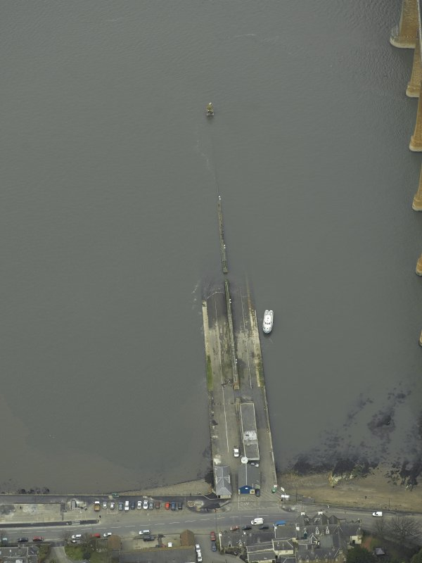 Oblique aerial view centred on the pier, slipway, lifeboat station and beacon, taken from the SW.