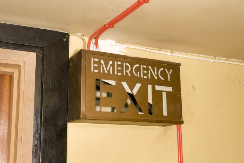 Interior. 3rd floor. Back stair. Emergency escape sign.