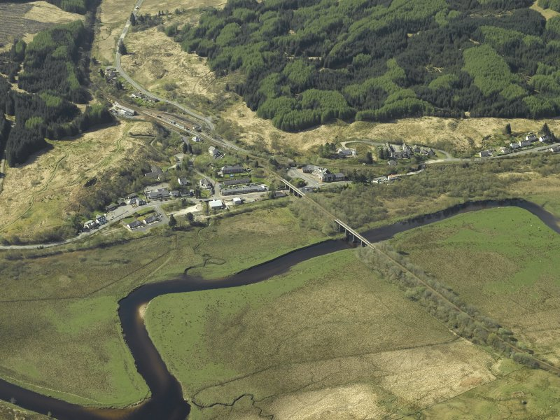 General oblique aerial view of the village centred on the railway viaduct, taken from the NE.