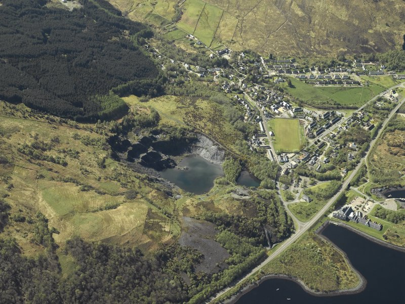 Oblique aerial view of the village centred on the slate quarries, taken from the NE.