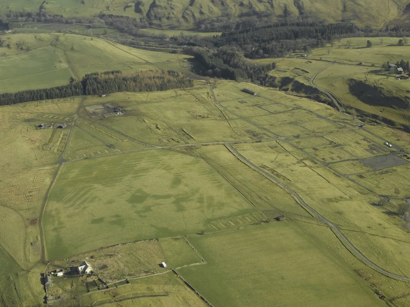 Oblique aerial view centred on Stobs Military Camp and Winningtonrig farmsteading, taken from the SW.