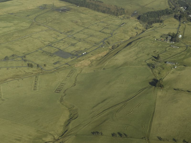 Oblique aerial view centred on Stobs Military Camp, taken from the SE.
