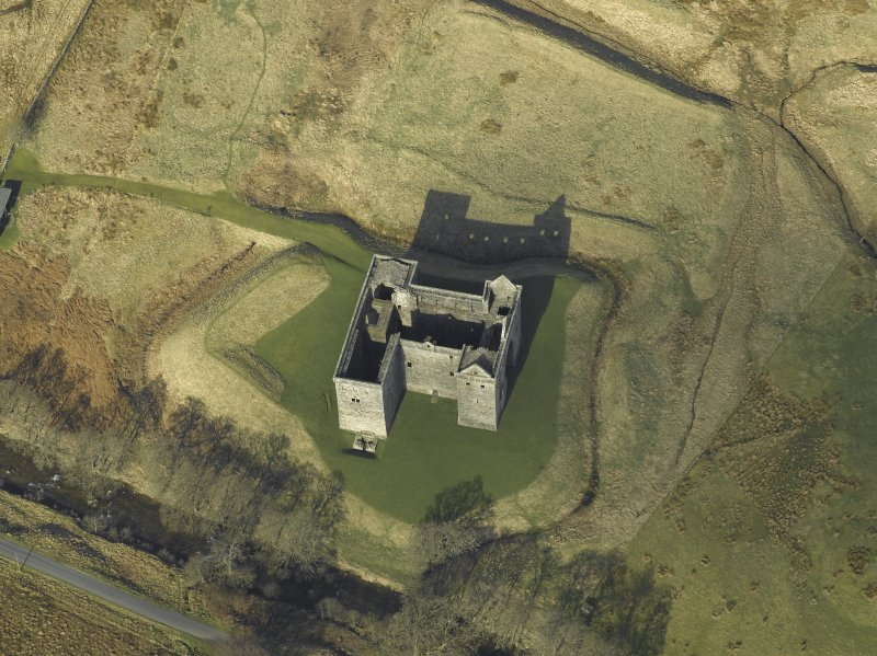 Oblique aerial view centred on the castle and moat, taken from the S.