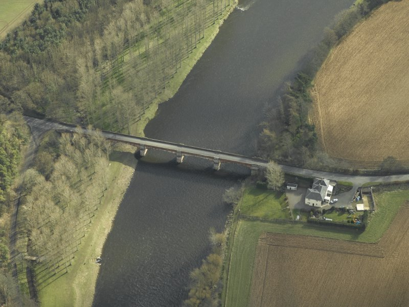 Oblique aerial view centred on Mertoun Bridge, taken from the NW.