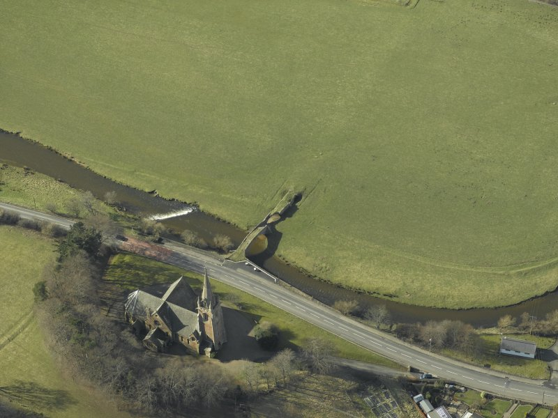 Oblique aerial view centred on Stow Kirk and Old Stow Bridge, taken from the NE.
