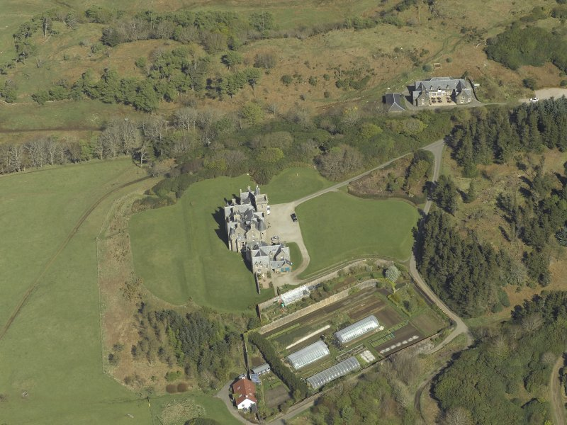 Oblique aerial view centred on the country house and walled garden, taken from the WSW.