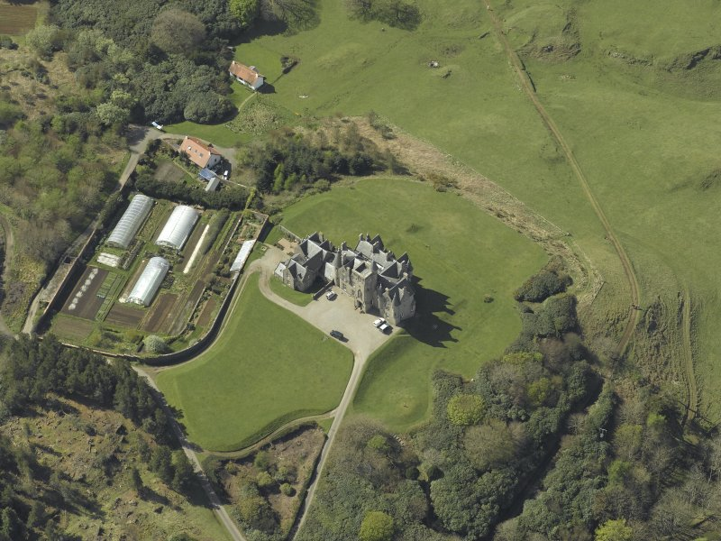 Oblique aerial view centred on the country house and walled garden, taken from the E.
