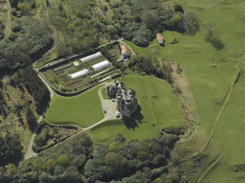 Oblique aerial view centred on the country house and walled garden, taken from the NE.