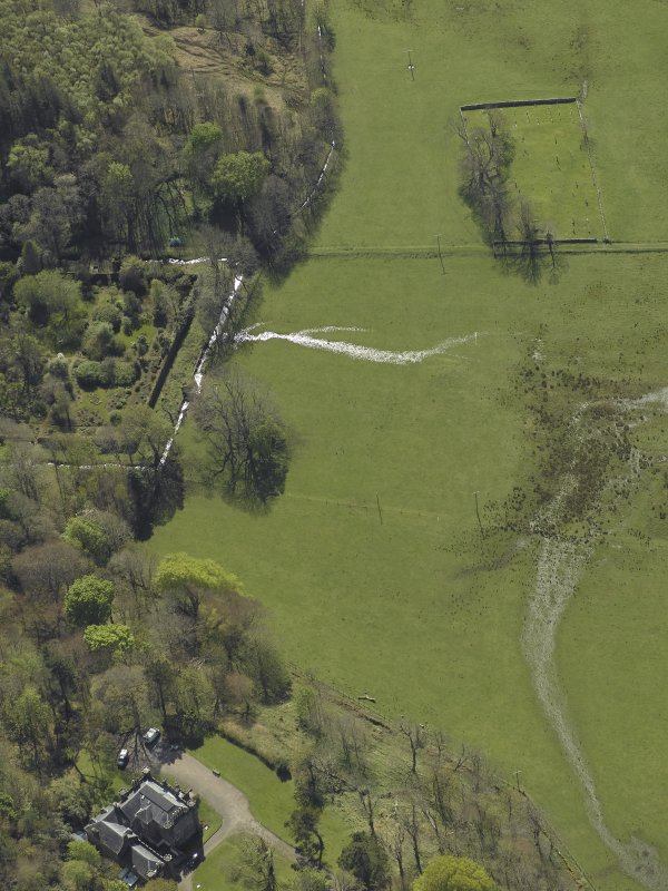 Oblique aerial view centred on the walled garden, country house and the remains of the burial-ground, taken from the NE.