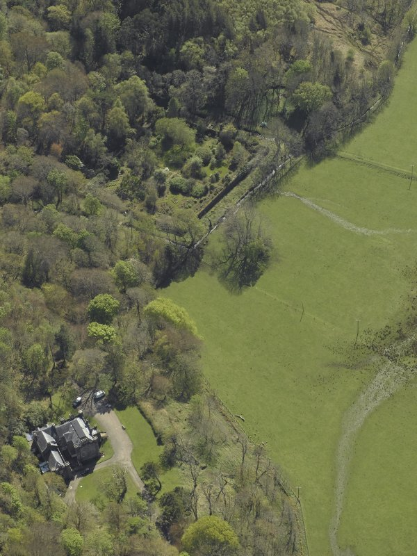 Oblique aerial view centred on the country house and walled garden, taken from the ENE.