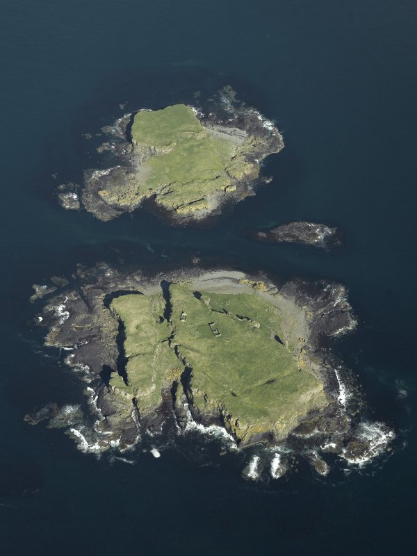 Oblique aerial view of the islands centred on the remains of the castles, taken from the WSW.