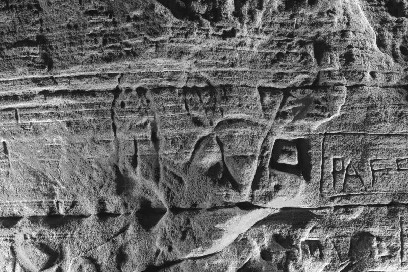 Detail of carving on cave wall at Sculptor's Cave, Covesea, showing fish and crescent and v-rod Pictish symbols (B&W)