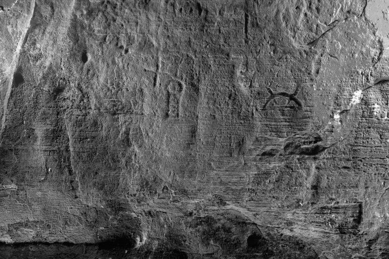 Detail of carving, including cross and crescent and V-rod Pictish symbol on wall of Sculptor's Cave, Covesea (B&W)