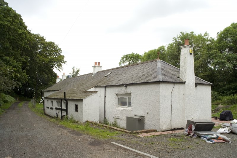 View looking N of former Blacksmith's cottage (foreground) and Manager's Office (background). Now private dwelling.